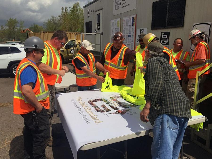Members of the O&G Newington Route 175 Bridge project sign a safety banner during the company's 2018 Safety Week.