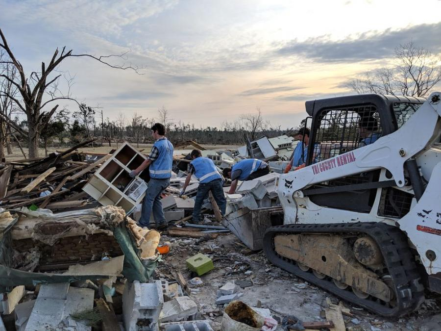 Members of the Rapid Response Team of Christian Aid Ministries helps with the cleanup following a pair of devastating tornadoes in southeastern Alabama.
