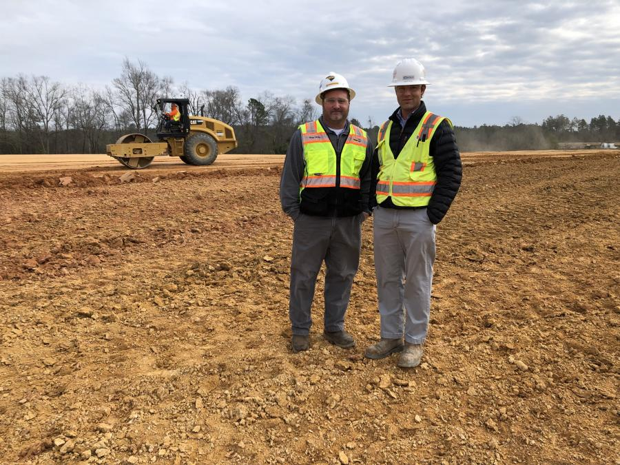 Heath Hanna (R), president of Contour Mining & Construction, visits a work site with Brian Smith, territory manager, Columbia, Blanchard Machinery.