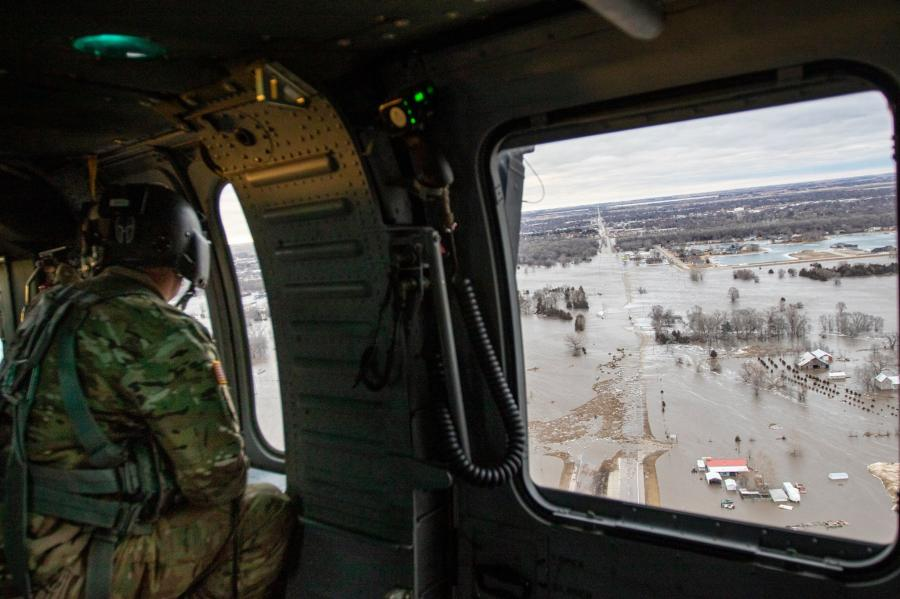 Nebraska National Guardsman surveys flood devastation from the air.