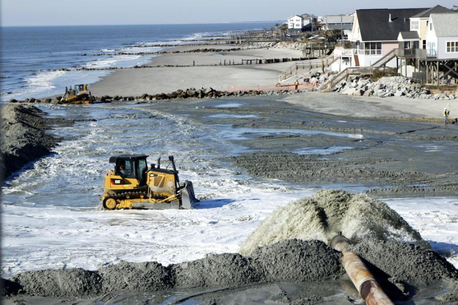 A view from the CRAB shows work progressing along the beach as dredged material flows from the pipeline.