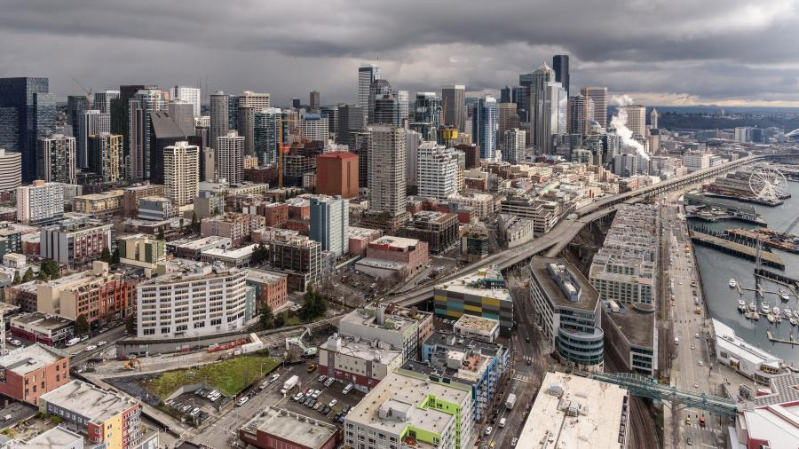 Looking southeast at the old Alaskan Way Viaduct. Look closely and you can see demolition under way in two places: the viaduct's north end near the Battery Street Tunnel, and farther south near Pike Place Market. (Washington State DOT photo)