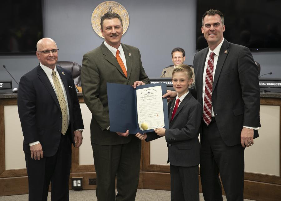 "Gov. Kevin Stitt presented the commission with a proclamation declaring April 1 to 14 ""Work Zone Awareness Days"" in Oklahoma. (L-R) are Transportation Commission Chairman David Burrage; Secretary of Transportation and ODOT Executive Director Tim Gatz; Remington Stitt, who was shadowing his father for a class project as governor for the day; and Gov. Stitt.