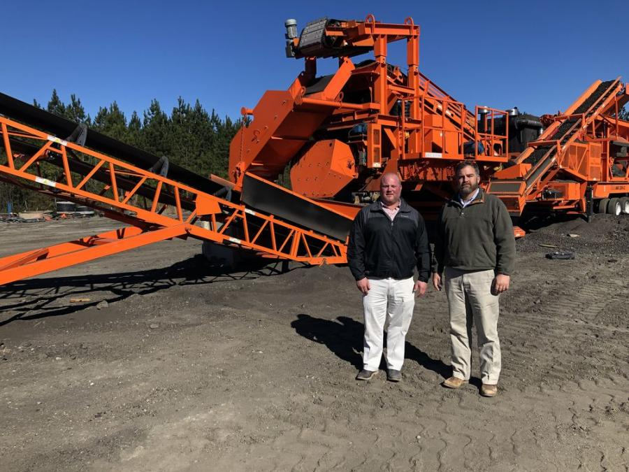 Nick Godwin (L), co-owner of Southern Asphalt, meets with Hill Machinery Company sales representative Dee Alesandro.