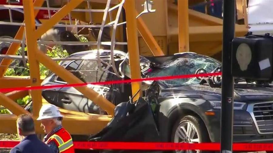 A 25-year-old mother and her 4-month-old daughter were in a car that was smashed by the crane on its passenger side, and both managed to escape with only minor injuries, Seattle Mayor Jenny Durkan said, calling it a miracle. (Photo Credit: NBC News)