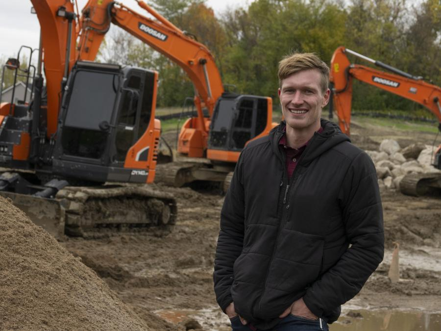 Matt Quinnell works for his parents' company, Advanced Wall Structures of Minnesota. Though he initially studied to be an engineer, he found he is happier spending up to 12 hours a day in an excavator, building stone walls.