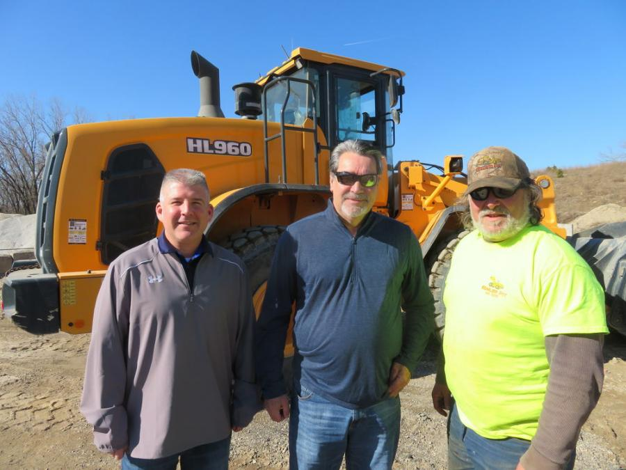 Discussing Kohler Pit's Hyundai HL 960 wheel loader (L-R) are Ed Harseim, district sales manager, Hyundai Construction Equipment Americas Inc.; Jon Christine, Yes Equipment & Services Inc.; and Jim Farrell of Kohler, the machine's operator.