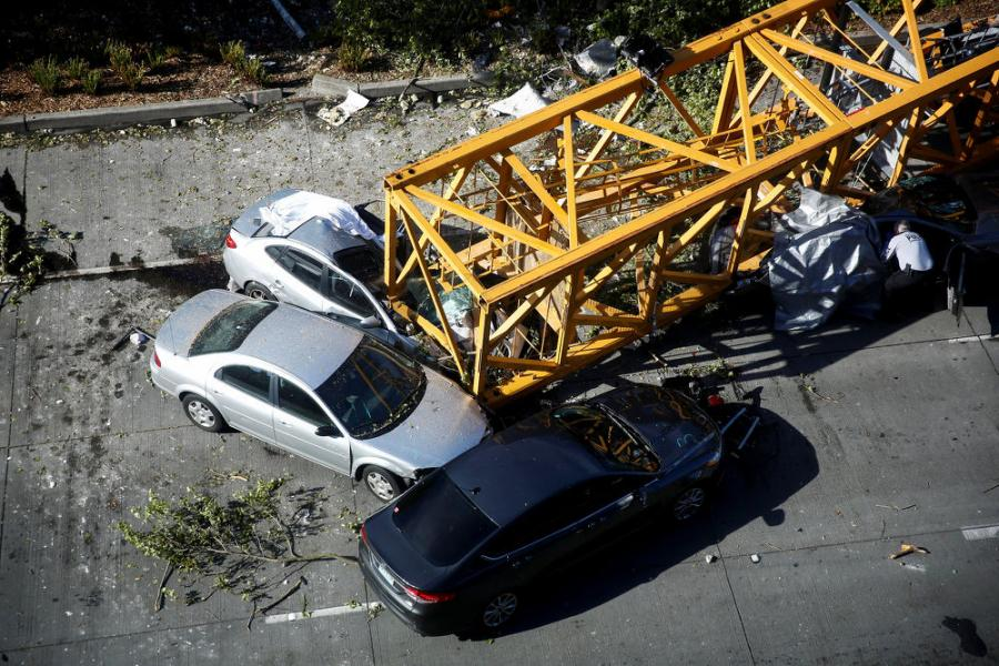 The crane's mast fell over on the afternoon of April 27, as workers were taking it apart. Sections landed on top of the new Google building where it had been used and on traffic below, striking six vehicles.