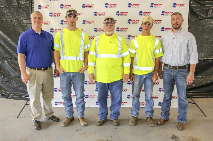 (L-R): Mississippi DOT District 1 maintenance engineer Matt Dunn (L) and assistant maintenance engineer Johnny Shields (R) congratulate Roadeo winners (L-R) Dennis Washington, first; Harold Johnson, second; and Joshua Curry, third.