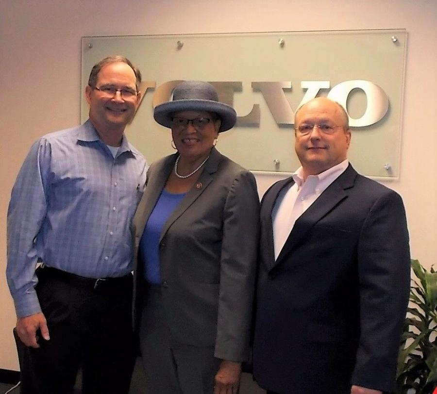 U.S. Rep. Alma Adams (C) visits with Bob Gorham (L), Ascendum Machinery's human resources director, and Ascendum CEO Kenny Bishop.