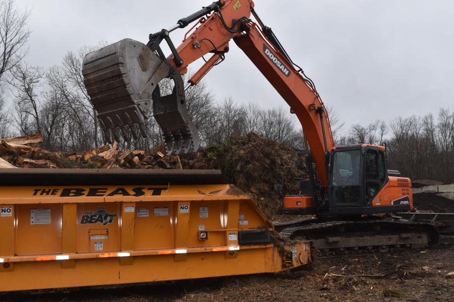 HH&P's Doosan DX225 excavator, purchased from Westchester Tractor, has proven to be a reliable workhorse at its wood waste recycling facility.