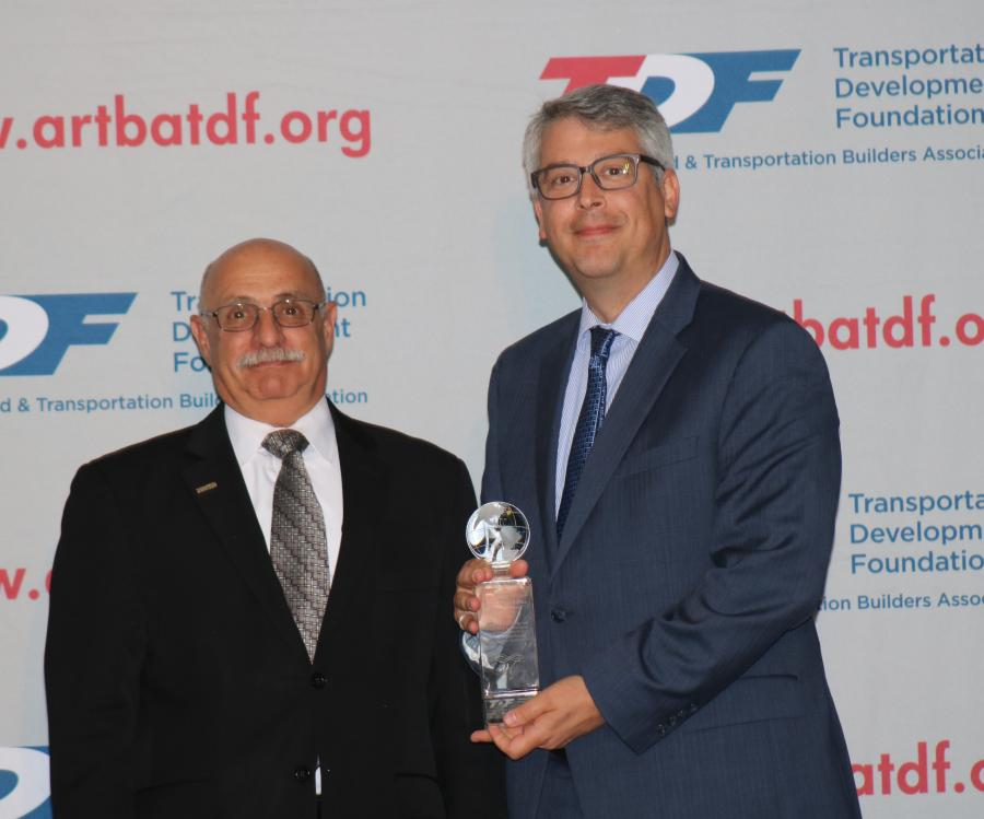 HDR representative Robert Victor (R) accepts the Globe Award for First Place project Herbert C. Bonner Bridge Replacement from ARTBA Foundation Chairman Paul Yarossi of HNTB.
