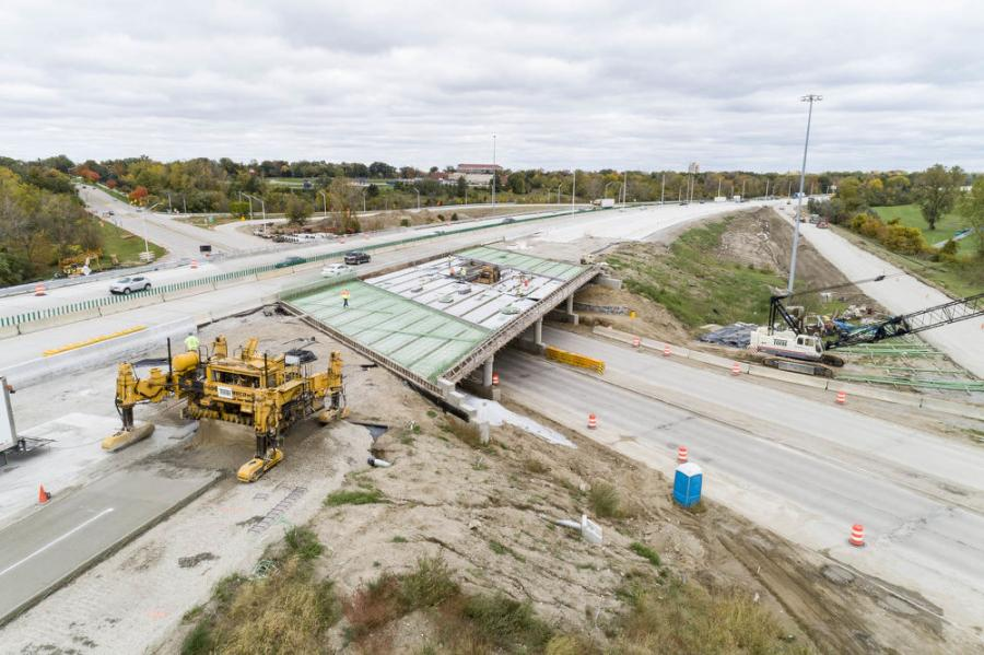 Work proceeds on the reconstruction of I-69 in Flint, Mich. The state Department of Transportation is using this and other road projects to test the longevity and costs of pavement set at various depths.