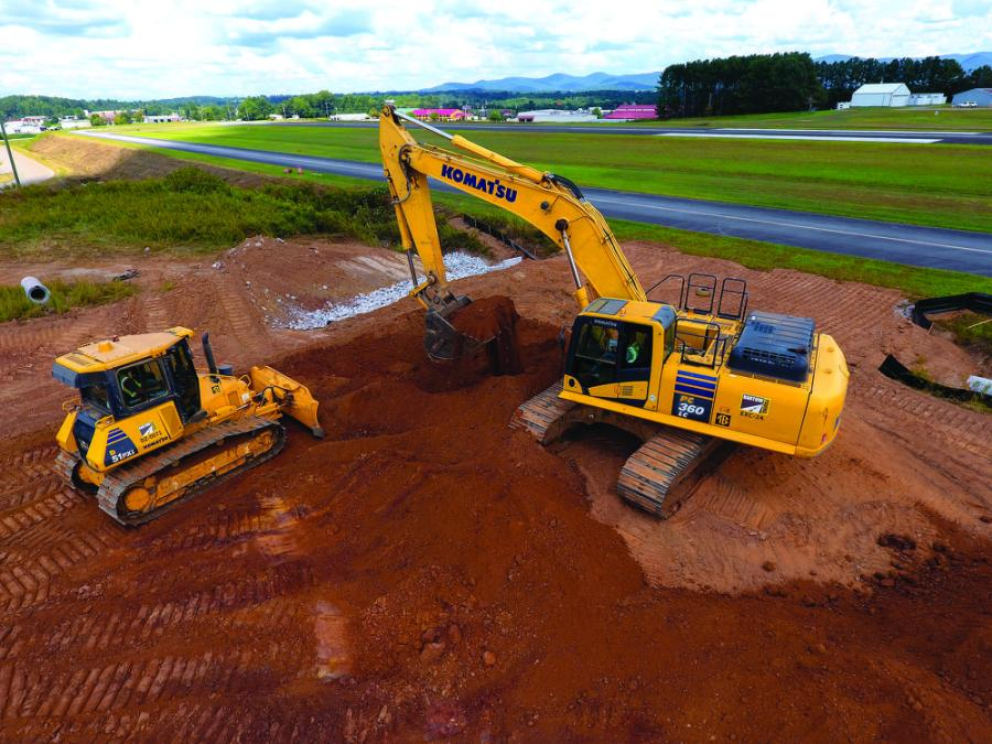 Two Bartow Paving Company operators work in tandem using a Komatsu PC360LC-10 excavator and Komatsu D51PXi-22 Intelligent Machine Control dozer to reach grade at the Pickens County Airport.