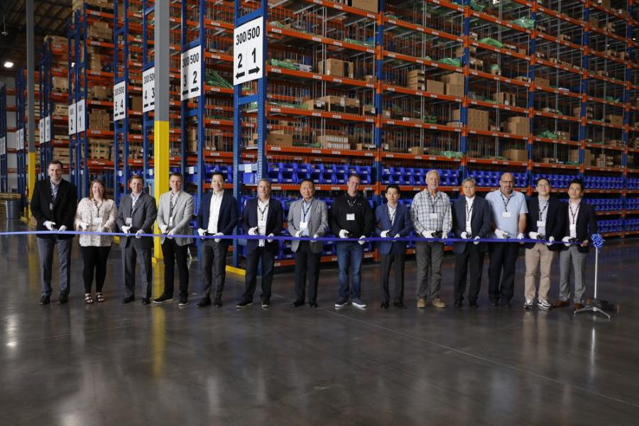Doosan staff and dealers celebrate the new Doosan parts distribution center in Lacey, Wash., with a ribbon-cutting.