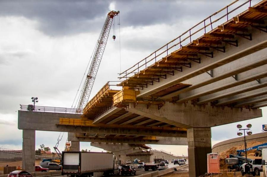 To create the interchange's five flyover ramps, large cranes have set 186 bridge girders above I-10 during weekend closures.