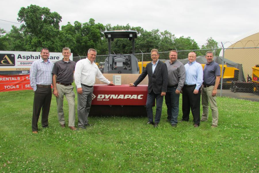 Standing in front of a Dynapac roller and with Asphalt Care's Top Ten dealer award (L-R) are Sean Engle, dealer sales manager, Dynapac; Dan Fackler, sales, Asphalt Care; David Fackler, president, Asphalt Care; Paul Hense, president, Dynapac; Bill Jainnini, sales and marketing director, Asphalt Care; Brian Bieller, president, Dynapac North America; and Paul Sablich, finance manager, Asphalt Care.