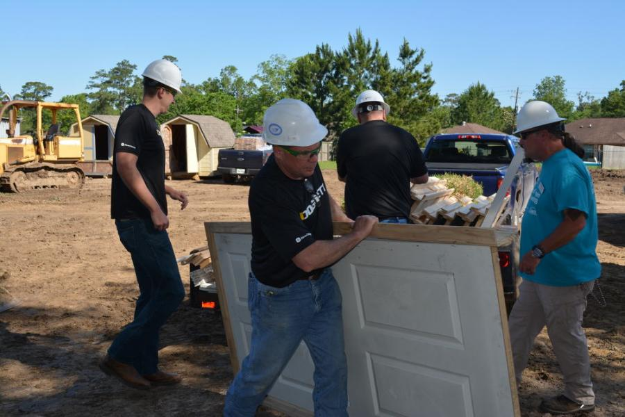 Mike Ortiz, vice president of Doggett's construction and forestry equipment division, led a team of about 20 volunteers from Doggett at a Habitat for Humanity jobsite in Beaumont, Texas.