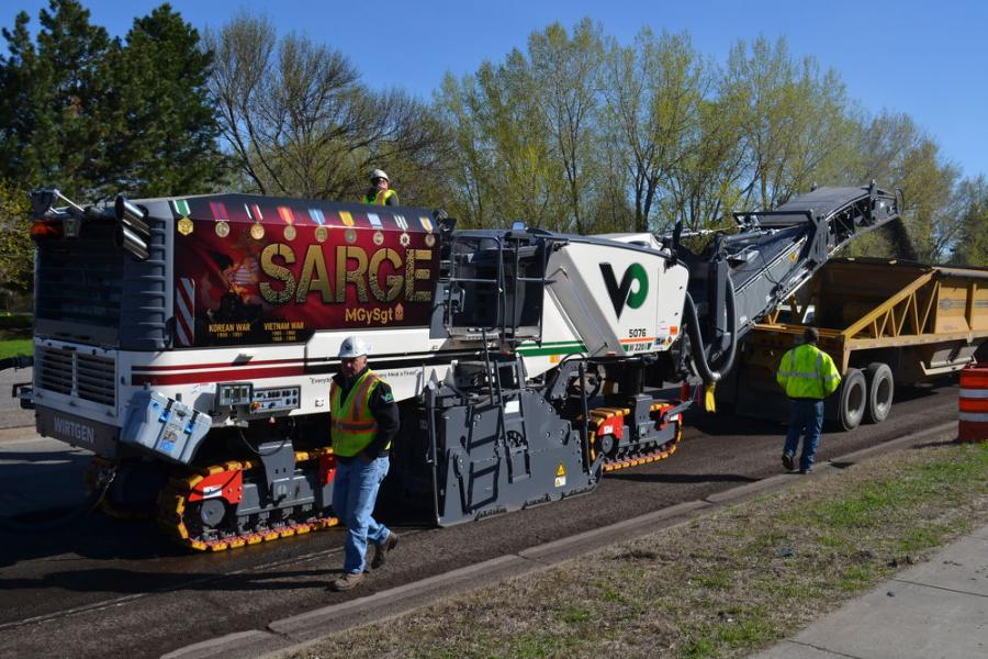 Valley Paving Inc. in Shakopee, Minn., elects to show the company's pride in the United States Armed Forces by applying decals of the flag and symbols of the various military branches onto each piece of equipment in its fleet.