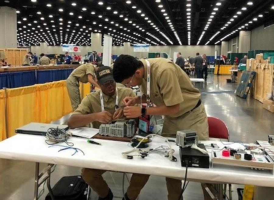 JCB Apprentices Anthony Smith and Victor De La Cruz compete at the SkillsUSA national championships in the mechatronics division.