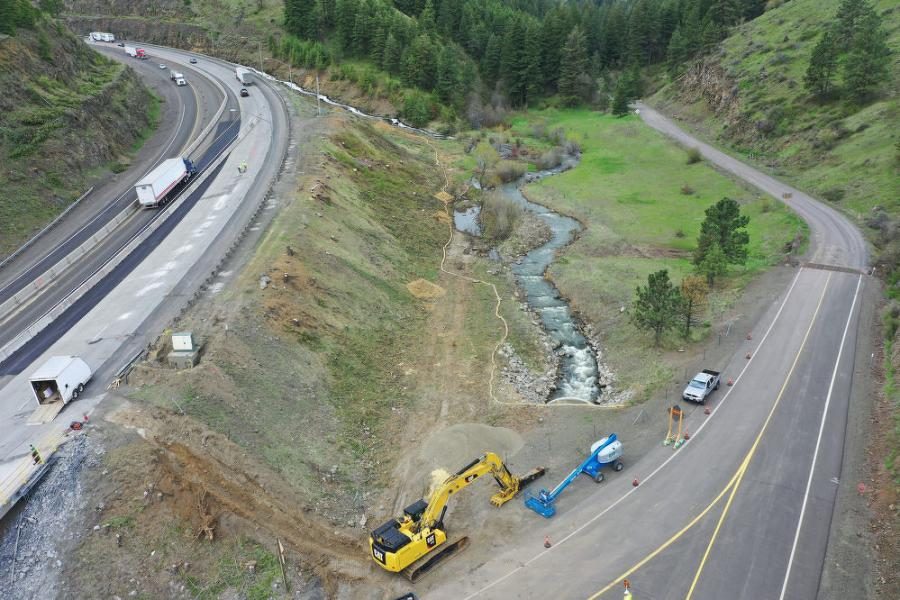 One of the challenges is that the work is occurring on a steep grade, in a narrow canyon and with the sharp curve at the bottom.