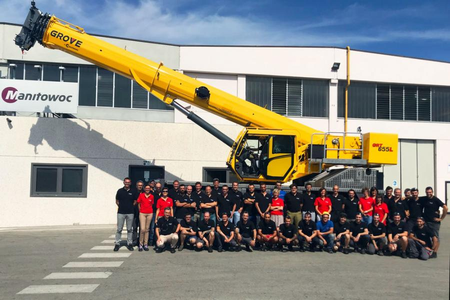 The Manitowoc employees who supported the project and workers from the assembly line stand in front of the first GRT655L produced in Manitowoc's factory in Niella Tanaro, Italy.