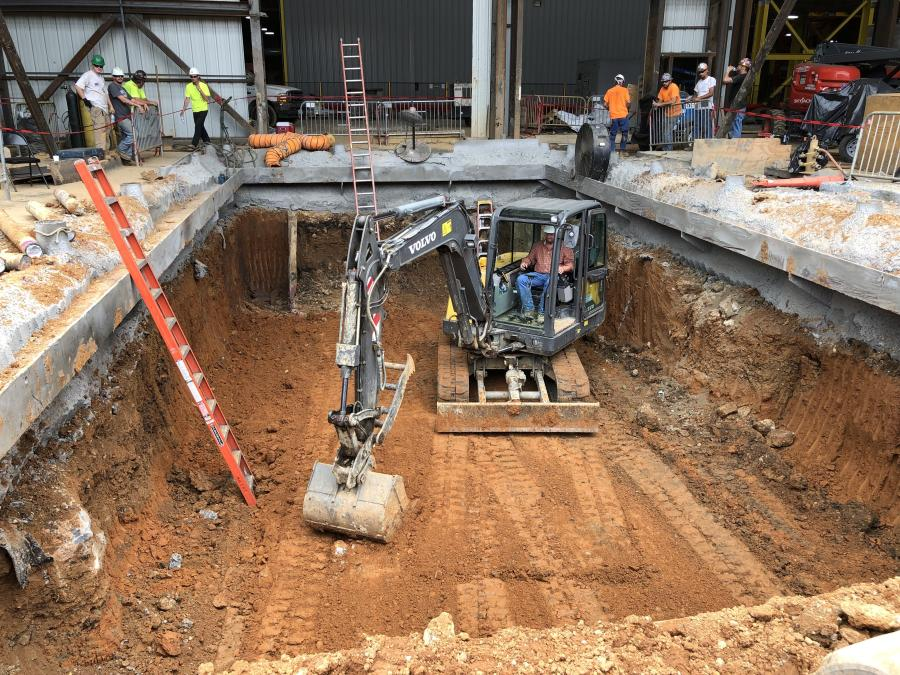 R.J. Sitton of Sitton Construction works inside a Volvo excavator purchased from Ascendum Machinery.