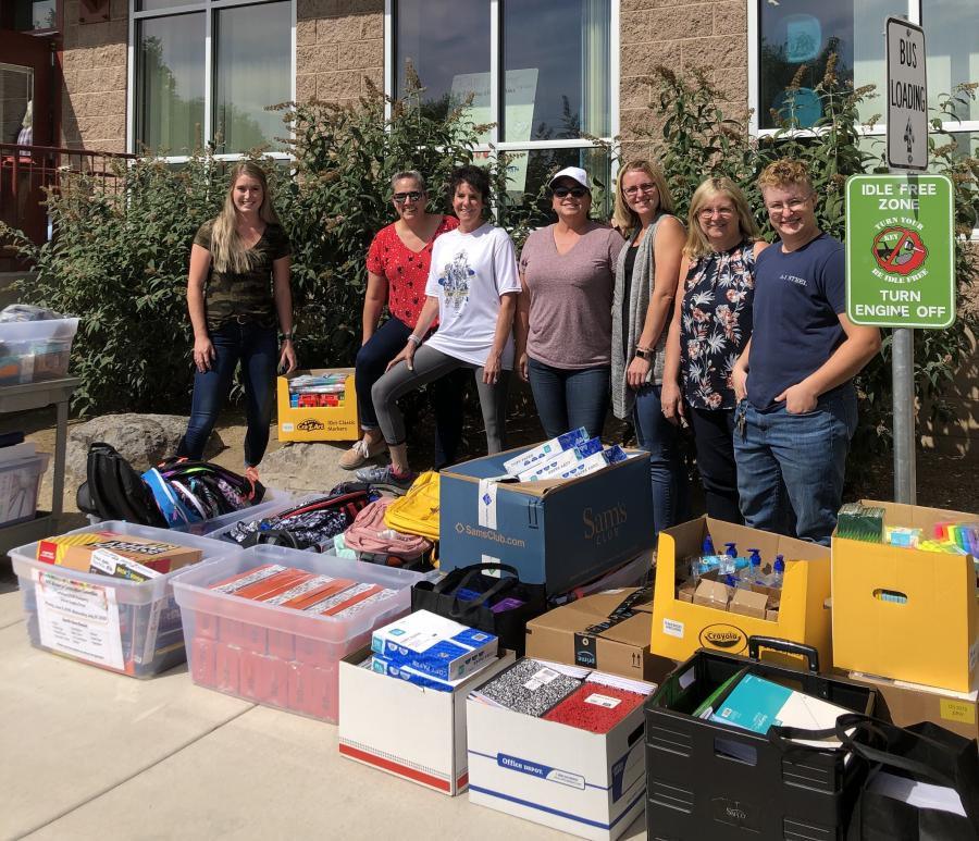 Members of the Women in Construction Committee present the supplies to Lemelson STEM Academy.