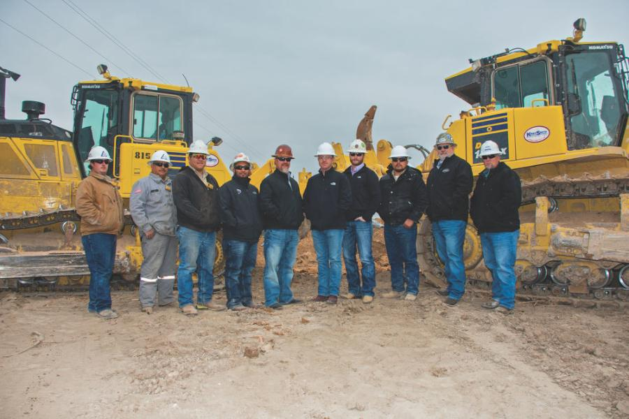 (L-R)  are Dorado Construction Group team members Julian Roberts, Florencio Pruneda, Drew Martinez, Gilbert Juarez, Clay Butler, Casey Poynor, Garrett Haney and Jesus Rivas taking time out for a photo with Kirby-Smith Machinery Territory Manager Ron Weaver and Product Support Sales Representative Cody Christopher.