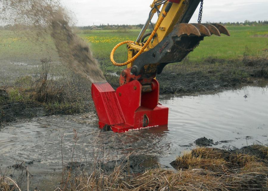 The Ditch Doctor chews up material with cutting heads, breaks it down and redistributes the spoils from a chute. The excavator operator has full control of the cutting depth and projection distance.