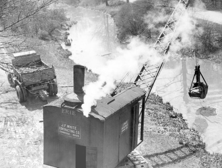 J. F. White using an Erie steam crane equipped with a clamshell crane to dredge the Muddy River near the intersection of Brookline Avenue and Riverway in Boston, Mass. The photo was taken on May 19, 1930. (Edgar A. Browning: J. F. White Collection photo)
