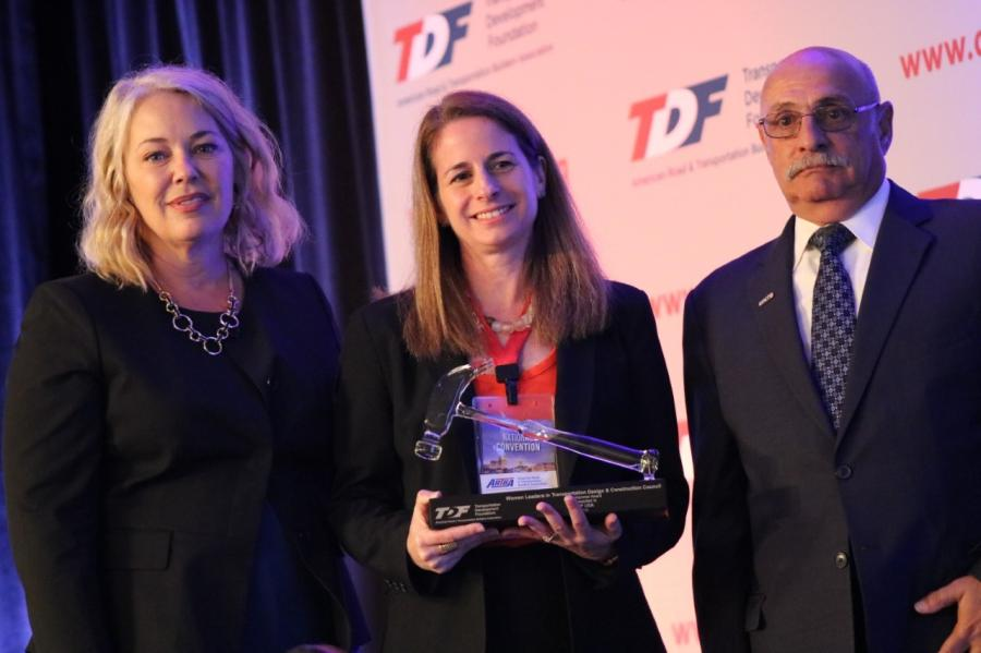 WSP USA Vice President Claudia Bilotto (C) accepts the Glass Hammer Award from ARTBA Women Leaders Council Chair Lisa Robert and ARTBA Foundation Chair Paul Yarossi.