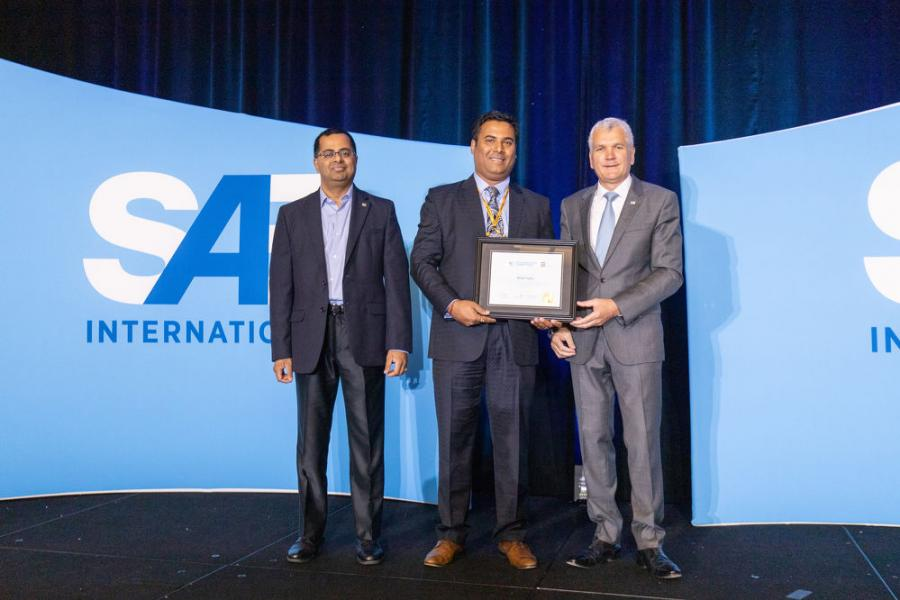 SAE-AEM Outstanding Young Engineer Rohit Saha (C) with Raman Venkatesh, SAE executive vice president and chief operating officer (L) and Paul Mascarenas, Venture Partner, Fontinalis Partners LLC and 2019 SAE International president.