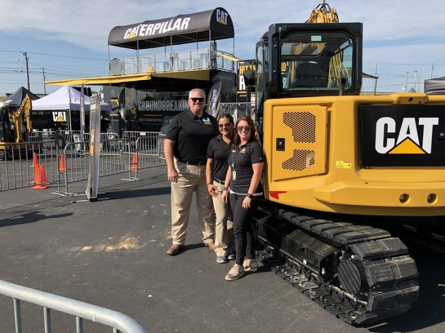 From the left are Mike Kunz of Carolina Cat, Edna Fortich of Caterpillar and Ashley McCluney of Richard Childress Racing in Welcome, N.C.