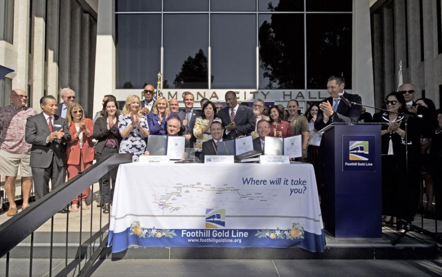 The Foothill Gold Line Construction Authority held a press conference on the steps of Pomona City Hall to sign the Alignment Design-Build Contract for the 12.3-mi., six-station Foothill Gold Line light rail project from Glendora to Montclair. 