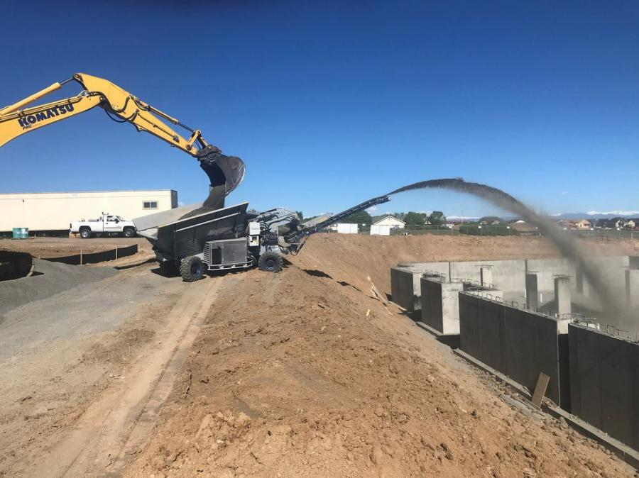 The OS7 is fitted with a 7-yd. hopper with wings leading to a 19-ft. long high-speed throw conveyor. It can be loaded with an excavator, wheel loader or even a skid steer loader.