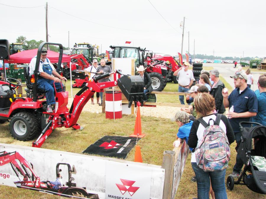 In a sea of static exhibits, attendees had the opportunity to operate a backhoe attachment on a Massey Ferguson GC1725M tractor in the AGCO exhibit area.