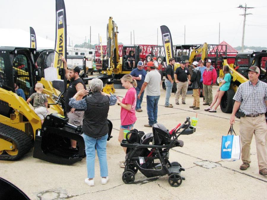 Attendees swarmed the Yancey Bros. Co. display area to see a vast array of Cat machines and attachments on display and to check out the 0 percent for 60 months finance deal they were promoting.