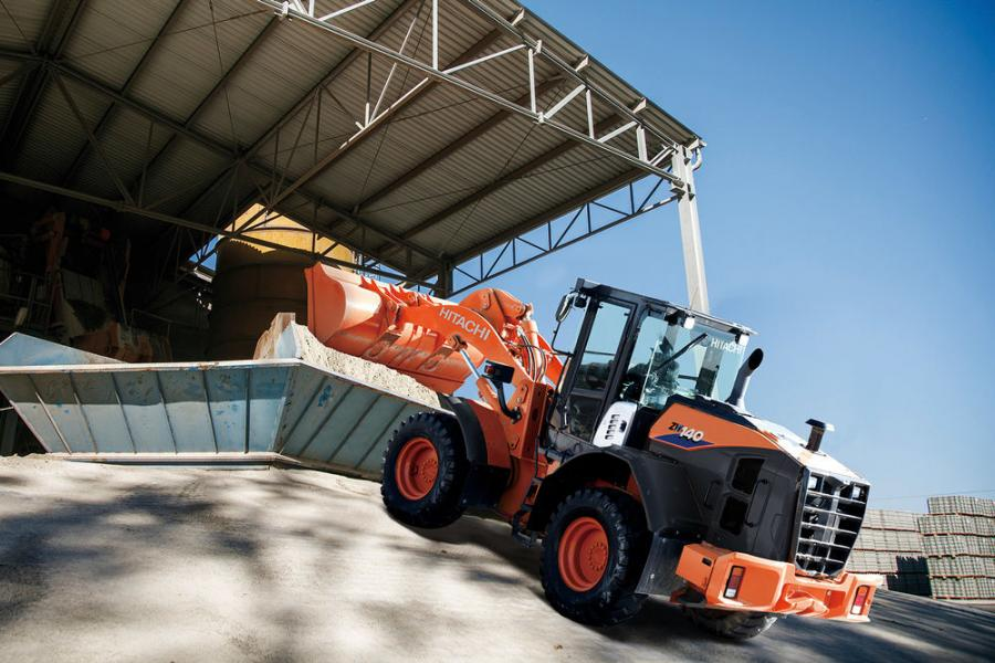 """Dash-6 models of Hitachi wheel loaders, including this ZW140-6 loader, all feature a new """"power mode"""" switch providing an instant boost in engine rpm to climb grades quickly under full load."""