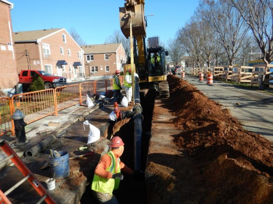 Crews install a new water main on Staten Island.