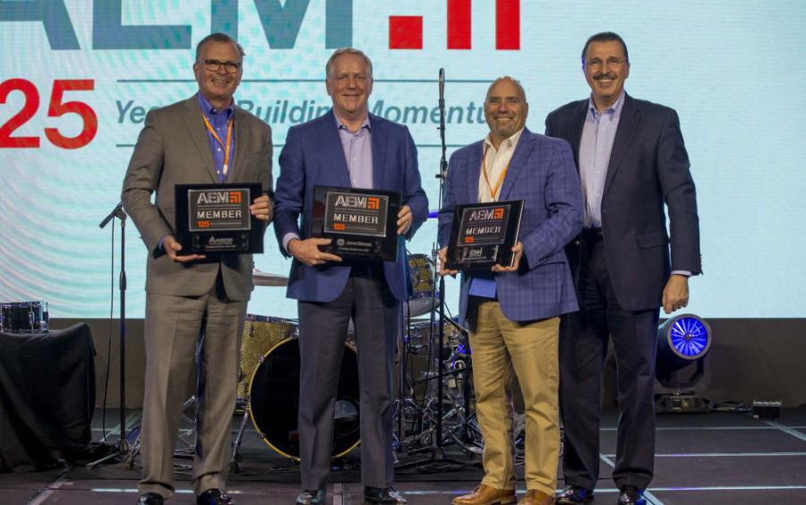 AEM's three 125-year member companies received recognition at the association's recent annual conference. Company representatives pictured (L-R) are: Robert Crain, AGCO; John Lagemann, Deere; and Scott Harris, CNH; with AEM President Dennis Slater.