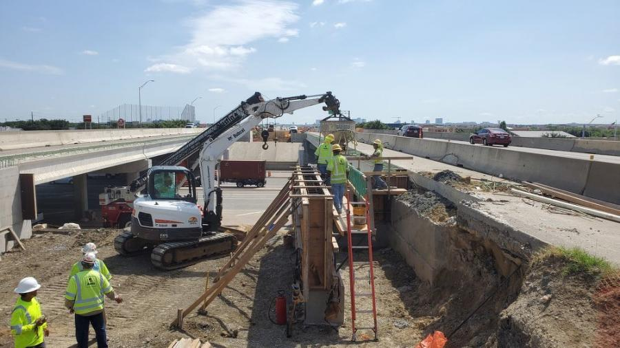 Completion of concrete paving, traffic rail and roadway striping from DNT to the KCS Railroad will be a major accomplishment for workers, as temporary barriers can be picked up and reset for work west of KCS.