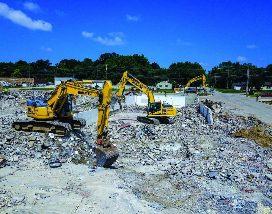 An Ozark Mountain crew uses Komatsu PC228USLC, PC210LC and PC360LC excavators to remove debris from a 100,000-sq.-ft. demolition project in Waynesville, Mo.