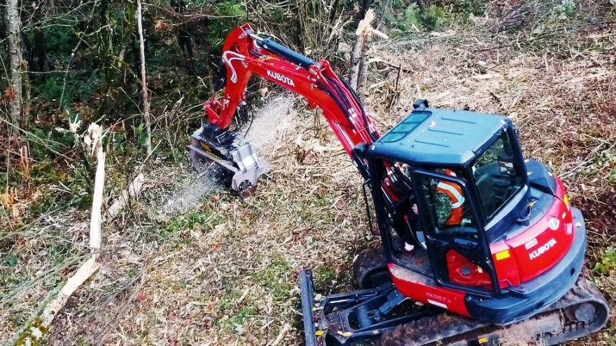 The demonstration Kubota KX057-4 mini-excavator with FAE forestry mulching head attachment makes quick work of felling and mulching trees.