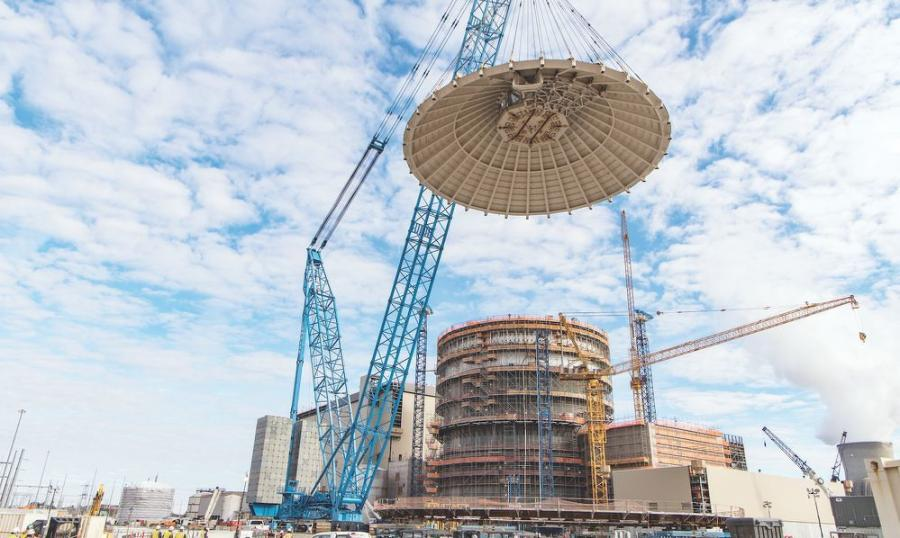 Weighing in at 2 million pounds, the roof of Unit 3's shield building is lifted into place.