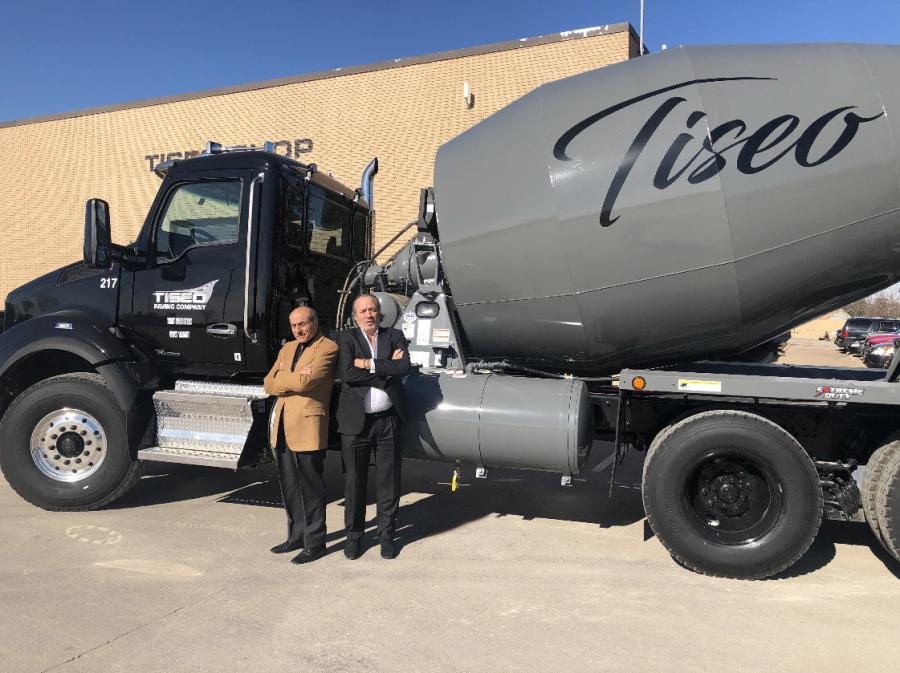 Art Tiseo (L) and his son, Louis Tiseo, both of Tiseo Paving, with one of the company's Kenworth T880s.