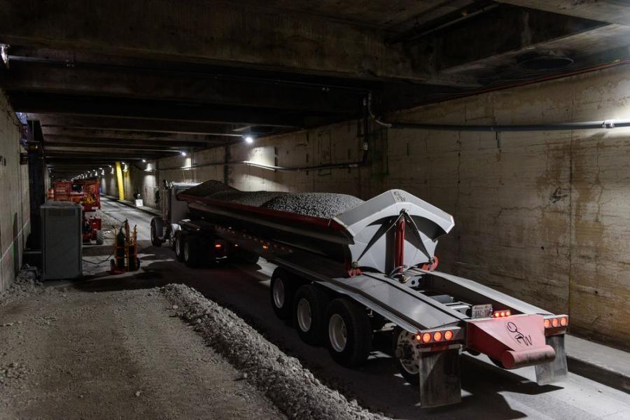 A dump truck brings fill material recycled from the demolition of the Alaskan Way into the Battery Street Tunnel. Contractor Kiewit Infrastructure West is using the concrete rubble as fill for the 65-year-old tunnel.