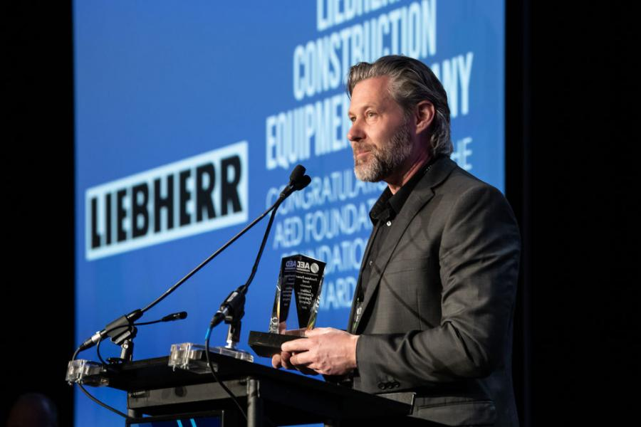 Peter Mayr, managing director of Liebherr USA Co., accepts the AED Foundation Partner Award in Chicago on Jan. 14, 2020.