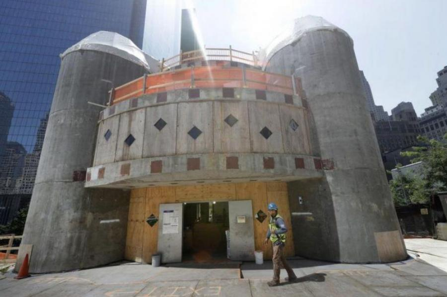 Construction company Skanska U.S.A. halted work on the church in December 2017 when the archdiocese ran out of money to complete the project. The half-finished church has been covered in white tarp since then.