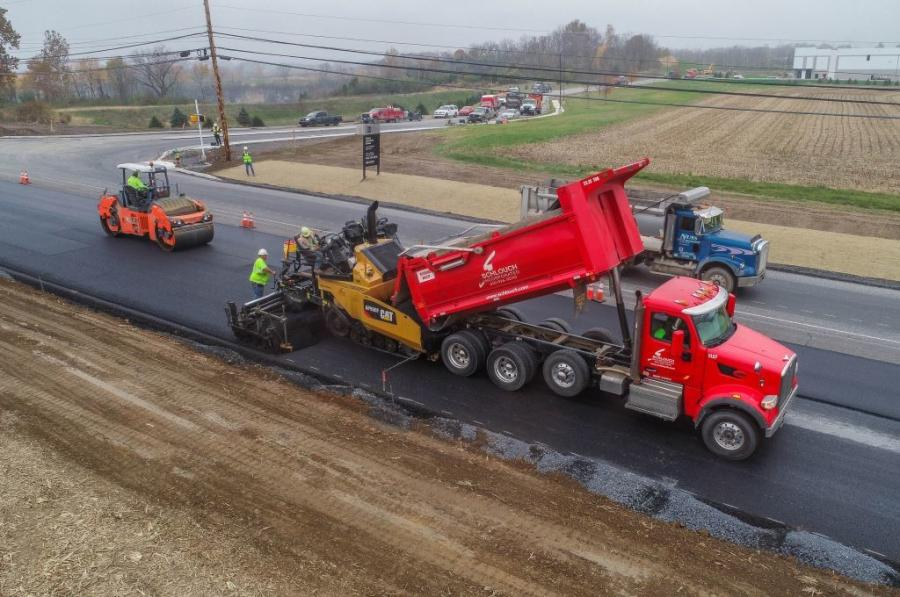 Schlouch Incorporated crews pave the entrance to Century Commerce Center. The 160-acre site is home to three warehouses.